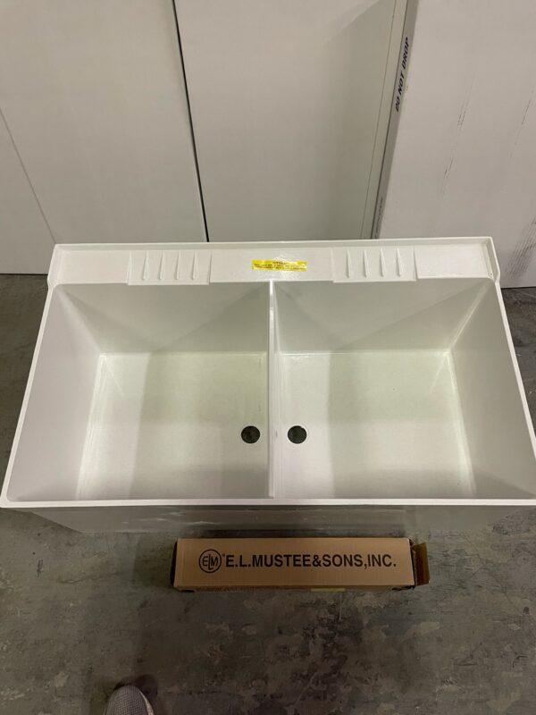 Durastone double tub floor mount sink, top view.