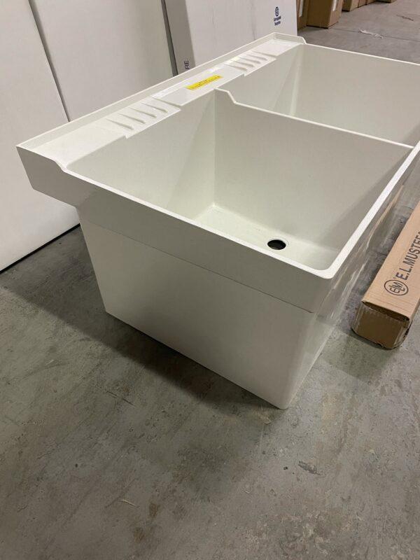 Durastone double tub floor mount sink, side view.