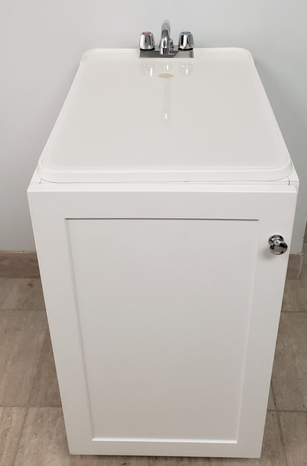 Laundry sink with white cabinet front view.