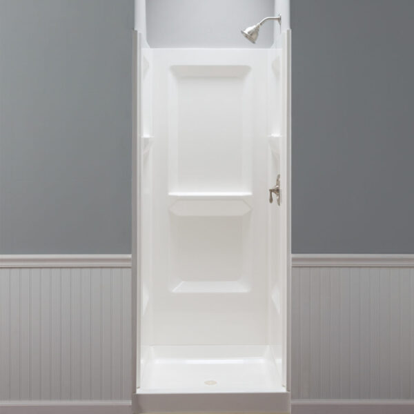 Mustee narrow shower walls with molded shelving.