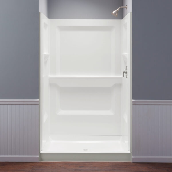 Mustee shower walls with molded shelves.